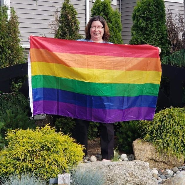 Aldergrove resident Lisa Ebenal hung the first flag on a sign on her private property as a show of support...