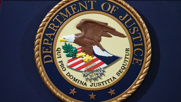 The Department of Justice seal is seen on a lectern ahead of a press conference announcing efforts against computer hacking and extortion at the Department of Justice in Washington, DC on November 28, 2018. (Photo by MANDEL NGAN / AFP)        (Photo credit should read MANDEL NGAN/AFP/Getty Images)