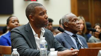 Author Ta-Nehisi Coates, left, and Actor Danny Glover, right, testify about reparation for the descendants of slaves during a hearing before the House Judiciary Subcommittee on the Constitution, Civil Rights and Civil Liberties, at the Capitol in Washington, Wednesday, June 19, 2019. (AP Photo/Pablo Martinez Monsivais)