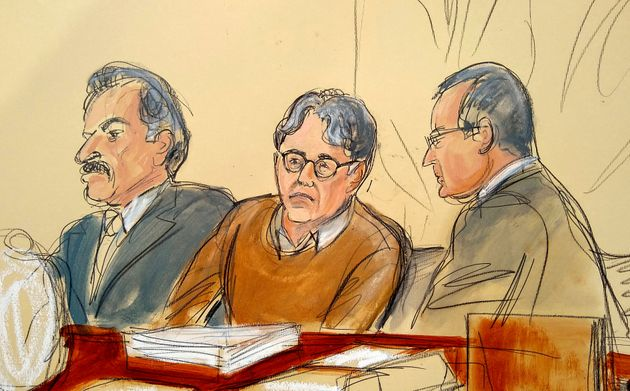 Keith Raniere, center in this courtroom drawing, during the first day of his sex trafficking trial on May...