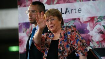 U.N. High Commissioner for Human Rights Michelle Bachelet waves as she exits the Simon Bolivar International Airport in Maiquetia, Venezuela, Wednesday, June 19, 2019. On her first visit to the South American country, Bachelet is expected to meet with Venezuelan President Nicolas Maduro and opposition leader Juan Guaidó — two men locked in a power struggle for control of the crisis-wracked nation. (AP Photo/Ariana Cubillos)