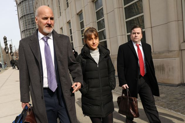 Actress Allison Mack leaves the Brooklyn Federal Courthouse with her lawyers on Feb. 6, 2019 in New York