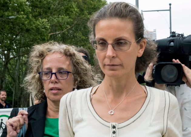 Clare Bronfman, right, leaves Federal court with her attorney in New York on July 25,