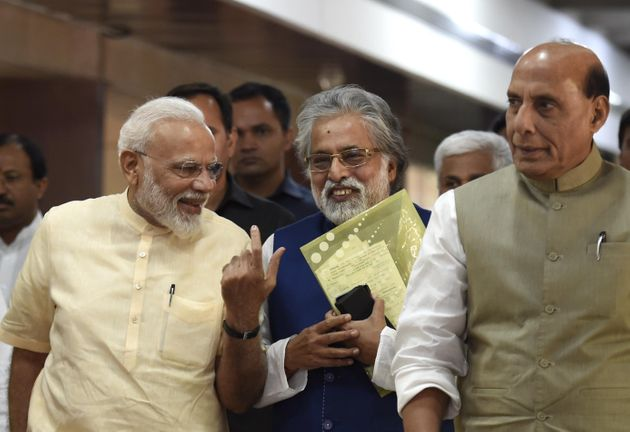 Prime Minister Narendra Modi with Defence Minister Rajnath singh and TMC leader Sudip Bandyopadhyay and...