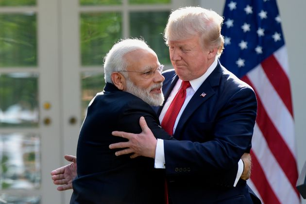 US President Donald Trump and Prime Minister Narendra Modi hug while making statements in the Rose Garden...