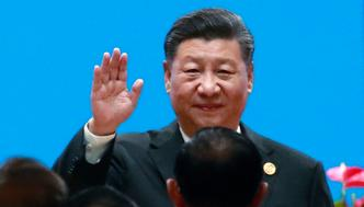 Chinese President Xi Jinping waves as he arrives for the opening ceremony of the Conference on Dialogue of Asian Civilizations in Beijing, China, Wednesday, May 15, 2019.(How Hwee Young/Pool Photo via AP)
