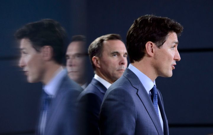 Prime Minister Justin Trudeau, right, makes an announcement regarding the government's decision on the Trans Mountain Expansion Project on Tuesday, June 18, 2019.