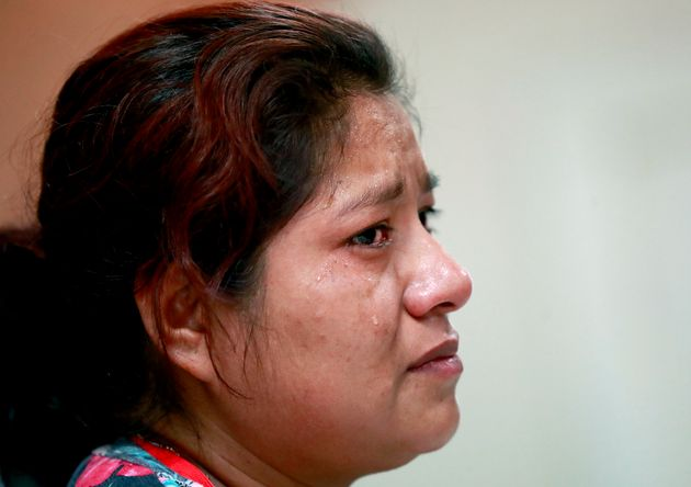 Miriam, from Guatemala, recounts her separation from her child at the border during a news conference...