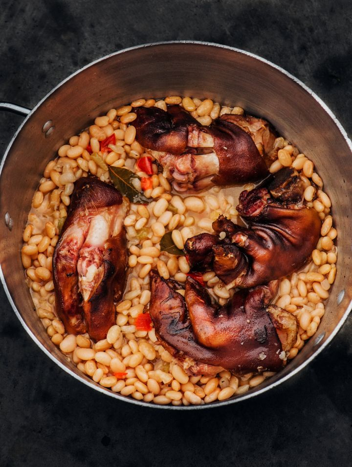 Isaac Toups suggests cooking trotters in beans, which soak up their rich flavor.