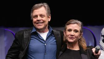 ANAHEIM, CA - APRIL 16:  Actors Mark Hamill (L) and Carrie Fisher speak onstage during Star Wars Celebration 2015 on April 16, 2015 in Anaheim, California.  (Photo by Jesse Grant/Getty Images for Disney)