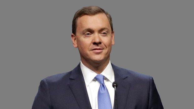 Chris Cox headshot, National Rifle Association lobbyist, graphic element on gray
