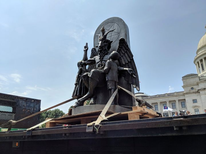 The Satanic Temple unveils its statue of Baphomet, a winged-goat creature, at a rally for the first amendment in Little Rock,