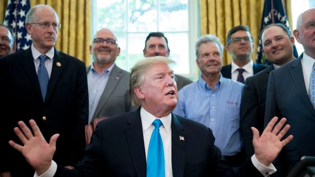 President Donald Trump, accompanied by Rep. Mike Conaway, R-Texas, left, Agriculture Secretary Sonny Perdue, right, and farmers and ranchers, speaks in the Oval Office of the White House, Thursday, May 23, 2019, in Washington. (AP Photo/Andrew Harnik)