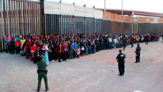 FILE - This May 29, 2019 file photo released by U.S. Customs and Border Protection (CBP) shows some of 1,036 migrants who crossed the U.S.-Mexico border in El Paso, Texas, the largest that the Border Patrol says it has ever encountered. The federal government is opening a new mass shelter for migrant children near the U.S-Mexico border and is considering housing children on three military bases to add 3,000 more beds to the overtaxed system in the coming weeks. (U.S. Customs and Border Protection via AP, File)