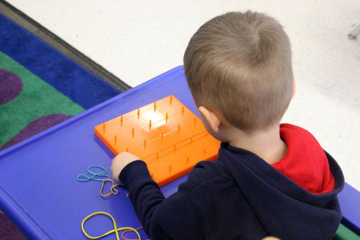 A student in Dysart Unified School District's developmental preschool program works on an activity during class.