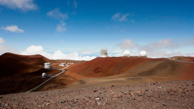 FILE - In this Aug. 31, 2015 file photo, telescopes are shown on Mauna Kea, Hawaii's tallest mountain and the proposed construction site for a new $1.4 billion telescope, near Hilo, Hawaii. On Friday, April 13, 2018, officials with the Thirty Meter Telescope International Observatory have delayed a decision whether to continue efforts to construct it at its preferred site in Hawaii or at an alternate site in Spain's Canary Islands. (AP Photo/Caleb Jones, File)