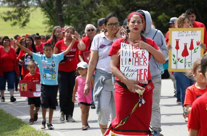 Miranda Muehl, of Mustang, Oklahoma, and others from the Cheyenne and Arapaho Tribes of Oklahoma march in June to demand action on missing and murdered indigenous women.