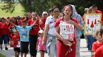 FILE - In this Friday, June 14, 2019, file photo, Miranda Muehl, of Mustang, Okla., marches during a march to call for justice for missing and murdered indigenous women at the Cheyenne and Arapaho Tribes of Oklahoma in Concho, Okla. A key congressional committee is holding a hearing on a slate of legislation aimed at addressing the deaths and disappearances of Native American women. The bills before the U.S. Senate Committee on Indian Affairs would require law enforcement to submit annual reports to Congress to give lawmakers a better handle on the number of cases. (AP Photo/Sue Ogrocki, File)