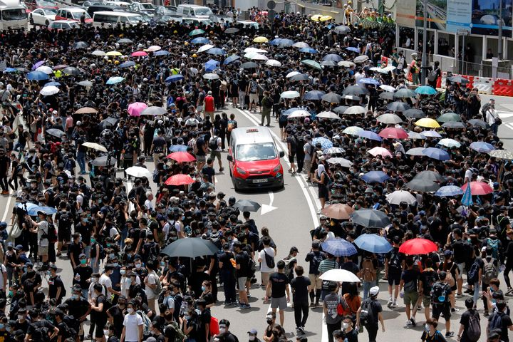 The protesters gathered outside Hong Kong government offices on Friday morning after a deadline passed for meeting their dema