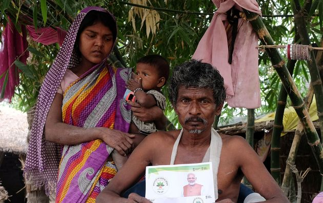 Nand Lal Mandhji, holds a letter about the Ayushman Bharat Medical Scheme, known as 'Modicare' as he...