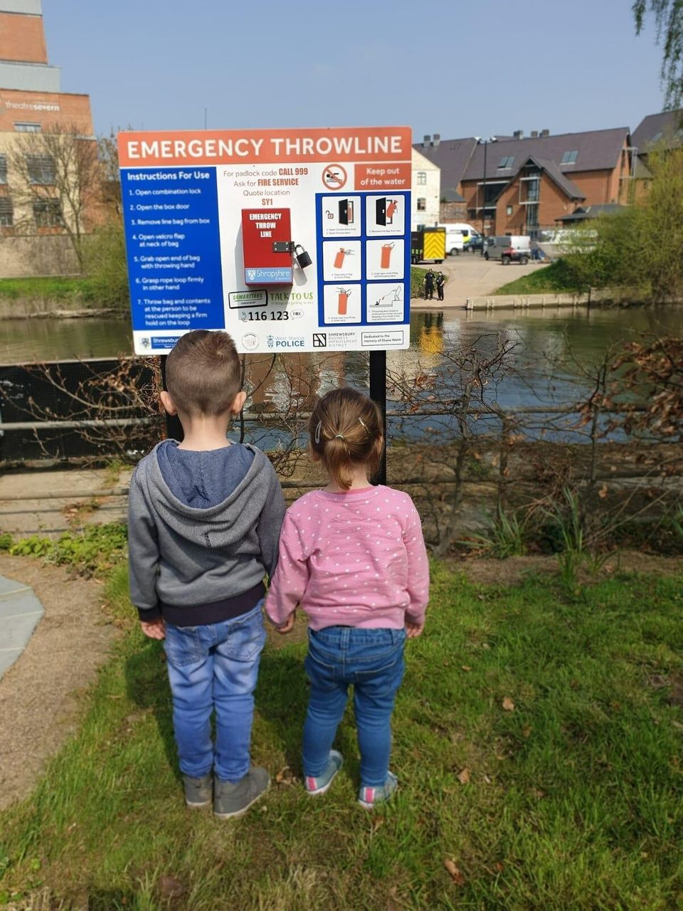 Corey and Adalynn Walsh in front of theemergency throwline, which was installed after Kirsty's