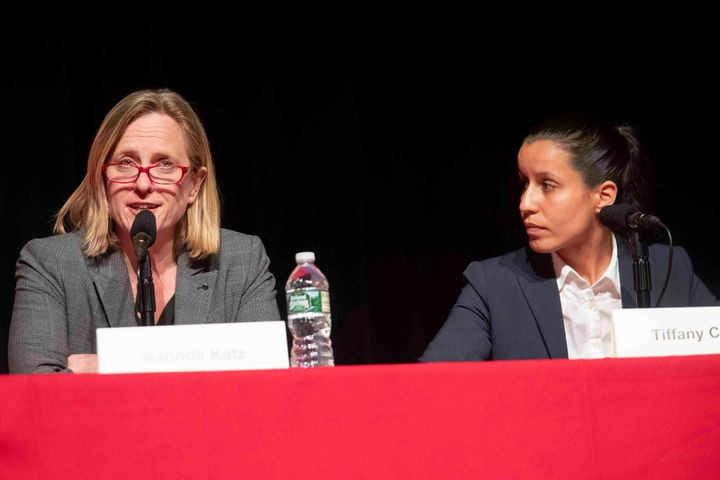 Queens Borough President Melinda Katz, left, speaks at a June 13 district attorney candidate forum as Cabán, right, lo
