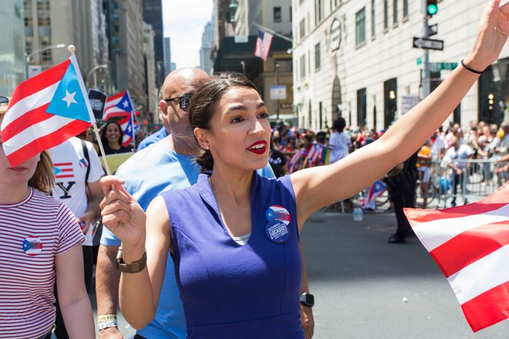 Rep. Alexandria Ocasio-Cortez (D-N.Y.) marches in the Puerto Rican Day Parade on June 9 in Manhattan. She has endorsed Cab&aa