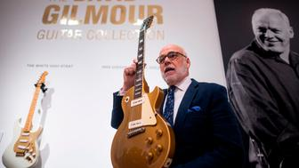 Kerry Keane, Christie's Musical Instruments Specialist holds a 1955 Gibson Les Paul, Golden Top Guitar from David Gilmour at Christie's on June 14, 2019 in New York City. - The personal guitar collection of Rock 'n' Roll legend, David Gilmour, guitarist, singer and songwriter of Pink Floyd goes on sale at Christie's New York on June 20. (Photo by Johannes EISELE / AFP)        (Photo credit should read JOHANNES EISELE/AFP/Getty Images)