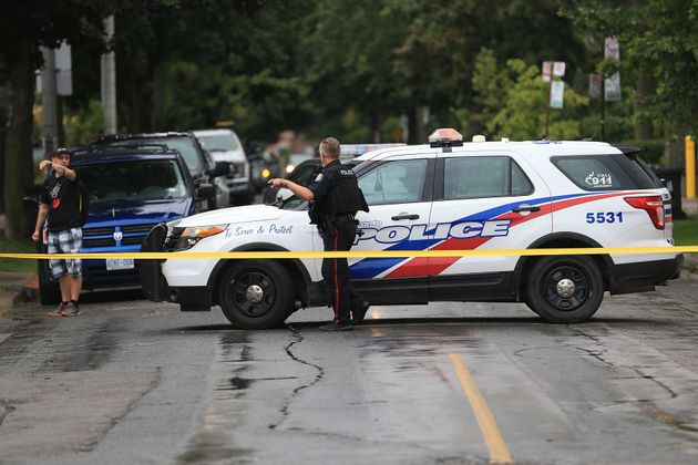 Police on the scene of a shooting in Toronto's Greektown neighbourhood on July 22,