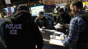 """NEW YORK, NY - APRIL 11:  U.S. Immigration and Customs Enforcement (ICE), officers prepare for morning operations to arrest undocumented immigrants on April 11, 2018 in New York City. New York is considered a """"sanctuary city"""" for undocumented immigrants, and ICE receives little or no cooperation from local law enforcement.  ICE said that officers arrested 225 people for violation of immigration laws during the 6-day operation, the largest in New York City in recent years. (Photo by John Moore/Getty Images)"""