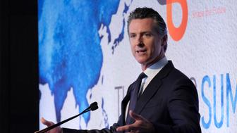 California Gov. Gavin Newsom speaks to The Pacific Summit of the Bay Area Council Friday, June 21, 2019, in San Francisco.  A proposal unveiled Friday by Newsom's office aims to stabilize California's investor-owned utilities and protect wildfire victims as the state faces increasingly destructive blazes, often caused by utility equipment. Pacific Gas & Electric Corp., the largest of the state's three investor-owned utilities, filed for bankruptcy in January as it stared down tens of billions of dollars in potential costs fires it started, including the fire last November that killed 85 people. (AP Photo/Eric Risberg)