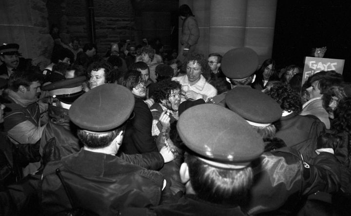 A man with blood streaming down his face scuffles with police outside the Ontario Legislature in Toronto on Feb. 6, 1981. About 1000 gay rights demonstrators marched there in protest of the arrests of 253 men in four city steam baths the night before.