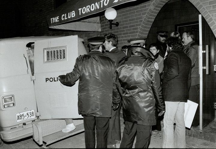 Police arrest patrons at a Toronto bathhouse as part of citywide raids Feb. 5, 1981.