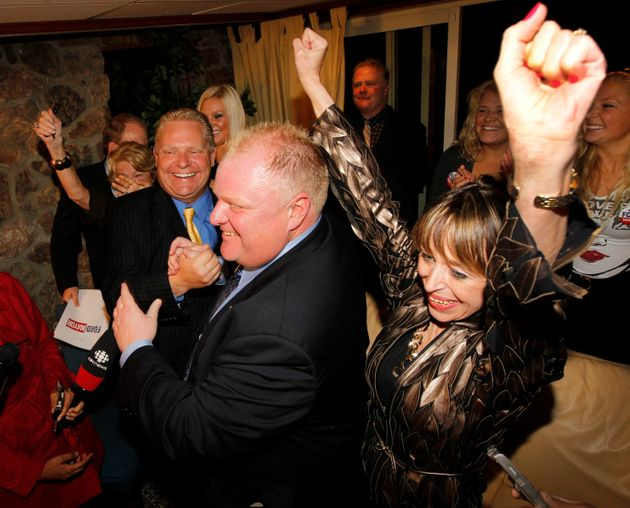 Rob Ford celebrates his election win with wife Renata and brother Doug in Toronto on Oct. 25,