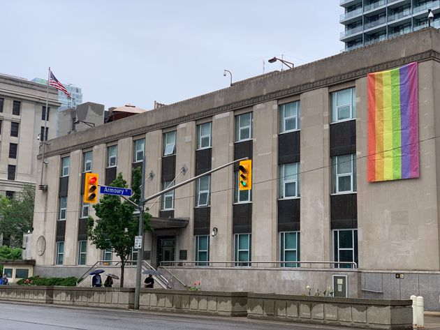 The Pride flag is draped over the U.S. consulate general building in