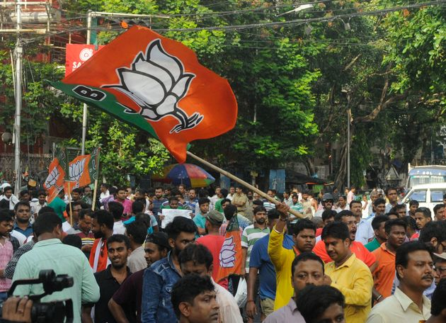 BJP supporters take out a protest rally against the alleged killing of two in