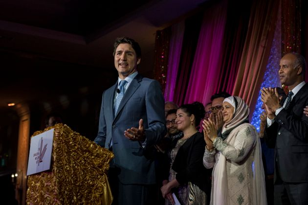 Trudeau is joined by members of the Liberal caucus while speaking at the Canadian Muslim Vote's Eid Dinner,...