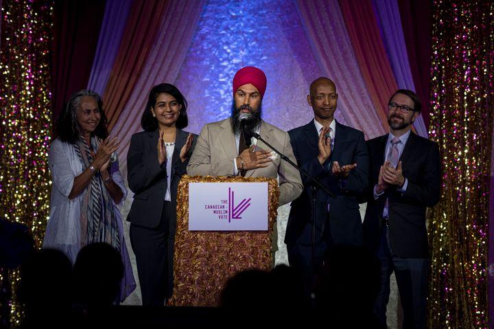 NDP leader Jagmeet Singh is joined by members of the NDP at the Canadian Muslim Vote's Eid Dinner, in Toronto, on June 21, 2019.