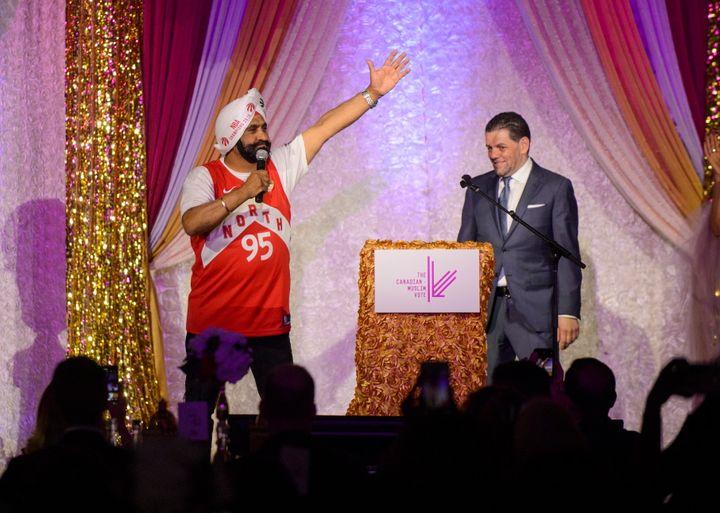 Toronto Raptors superfan Nav Bhatia speaks to a crowdat the Eid Dinner with Paramount Fine Foods owner Mohamad Fakih in Toronto, on June 21, 2019.
