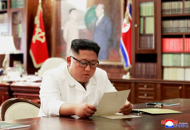 The state-run Korean Central News Agency included a photo of Kim Jong Un apparently reading a letter...