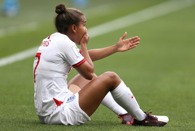 England's Nikita Parris is fouled by Cameroon's Yvonne