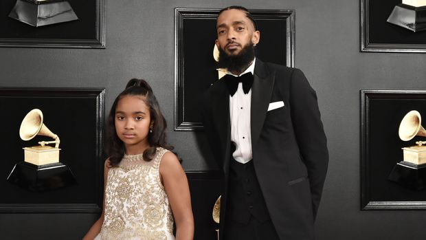 LOS ANGELES, CALIFORNIA - FEBRUARY 10: Emani Asghedom and Nipsey Hussle attend the 61st Annual Grammy Awards at Staples Center on February 10, 2019 in Los Angeles, California. (Photo by David Crotty/Patrick McMullan via Getty Imagess)