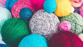 Colored balls of yarn. Colorful background with yarn ball