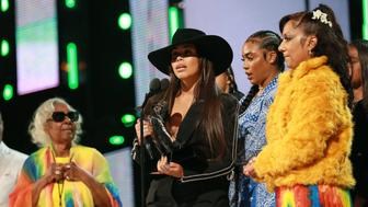 LOS ANGELES, CALIFORNIA - JUNE 23: Nipsey Hussle's family and Lauren London accept Humanitarian Award on behalf of Nipsey Hussle onstage at the 2019 BET Awards at Microsoft Theater on June 23, 2019 in Los Angeles, California. (Photo by Leon Bennett/VMN19/Getty Images for BET)