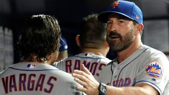 New York Mets manager Mickey Callaway, right, pats starting pitcher Jason Vargas (44) on the back after Vargas pitched through five innings during a baseball game against the Miami Marlins, Tuesday, April 2, 2019, in Miami. (AP Photo/Lynne Sladky)