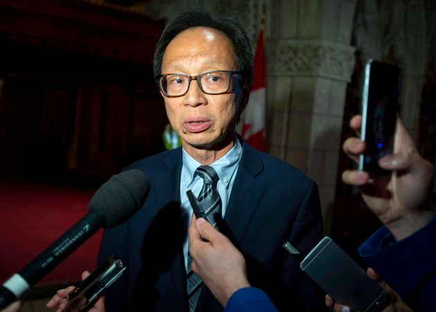 Sen. Yuen Pau Woo speaks to reporters in Ottawa on June 19,
