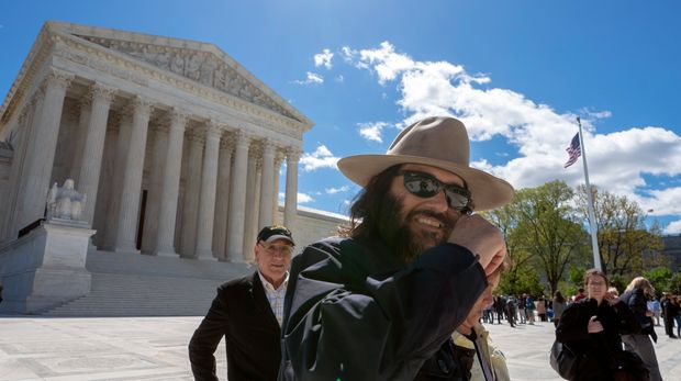 """Los Angeles artist Erik Brunetti, the founder of the streetwear clothing company """"FUCT,"""" leaves the Supreme Court after his trademark case was argued, in Washington, Monday, April 15, 2019. Brunetti, who says the brand name is an acronym for """"Friends U Can't Trust,"""" is seeking help from the high court after he was denied a trademark by the U.S. Patent and Trademark Office because of a portion of federal law that says officials should not register trademarks that are """"scandalous"""" or """"immoral."""" (AP Photo/J. Scott Applewhite)"""