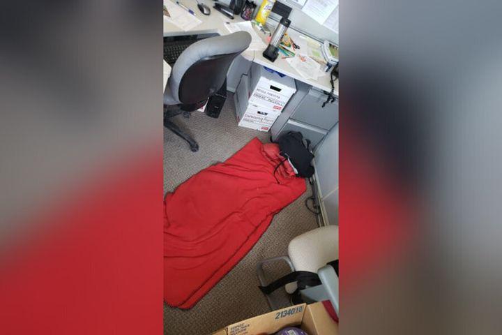 Caroline Robinson often sleeps in this sleeping bag on her office floor.