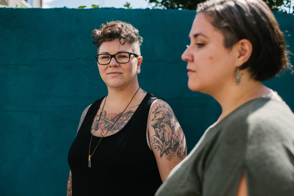 Dese'Rae Stage (left) and Felicidad Garcia, who both struggled with infertility, pose at their Philadelphia home on June 20, 2019.