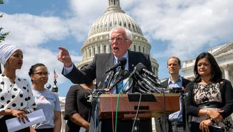 Democratic presidential candidate, Sen. Bernie Sanders, I-Vt., flanked by Rep. Ilhan Omar, D-Minn., left, and Rep. Pramila Jayapal, D-Wash., right, calls for legislation to cancel all student debt, at the Capitol in Washington, Monday, June 24, 2019. Sanders called the student debt burden in this country the absurdity of sentencing an entire generation, the millennial generation, to a lifetime of debt for the crime of doing the right thing. (AP Photo/J. Scott Applewhite)